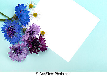 Greetings card with flowers on blue background.