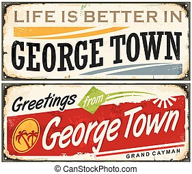 Greetings from George Town Grand Cayman. Vintage souvenir tin signs set with popular Caribbean destination.