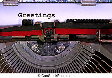 greetings written with black ink with the old typewriter