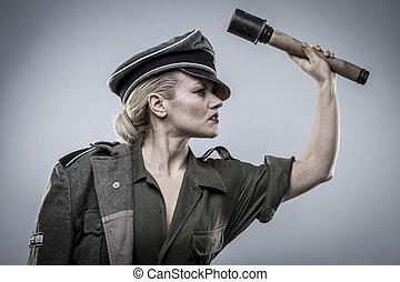 Grenade. German officer in World War II, reenactment, soldier beautiful woman