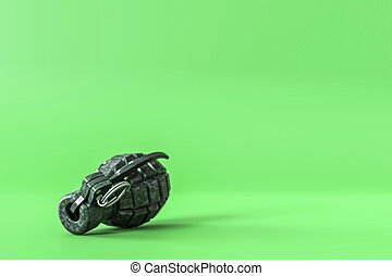 Grenade isolated on green background