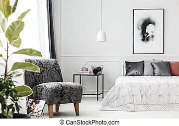 Grey armchair in bedroom