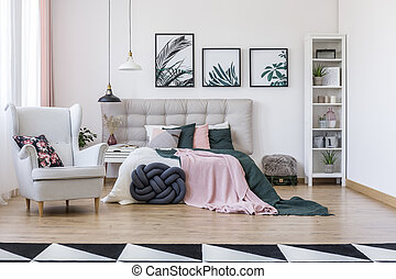 Grey armchair in bedroom interior