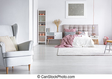 Grey armchair in cozy bedroom