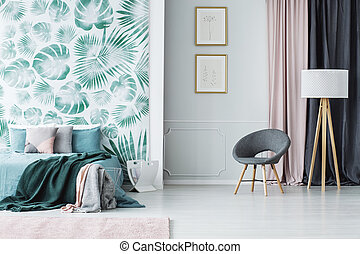 Grey armchair in green bedroom