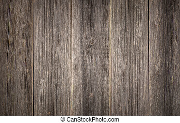 Weathered grey background detail of vertical barn wood boards.