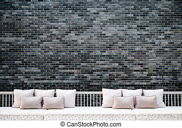 Grey Brick wall and coach, sofa
