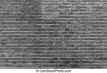 Grey brick wall as background.