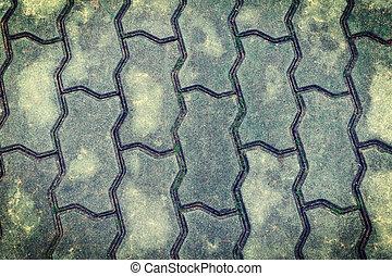 Grey bricks at the ground
