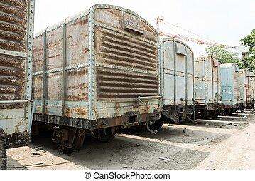 Grey cargo train carriage in train yard, taken on a sunny...