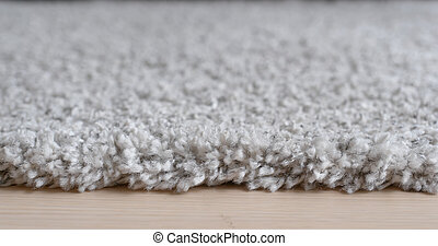 Grey carpet on the floor at home