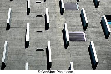 Grey cement facade of modern building