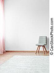 Grey chair in bright interior