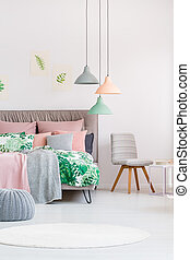 Grey chair in colourful bedroom