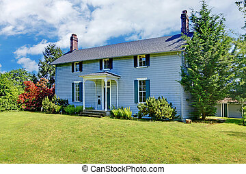 Grey classic historical home from 1856 in Washington State.