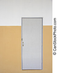 Grey doors on orange wall and white wall