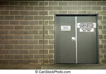 garbage room - grey doors to garbage room, grey brick wall,...