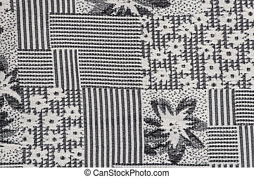 Grey fabric background with flower pattern close-up