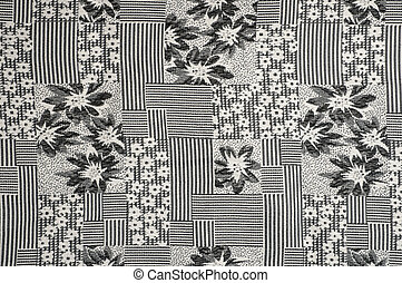 Grey fabric background with flower pattern closeup