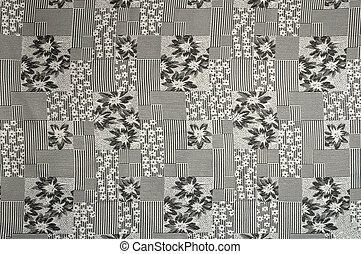 Grey fabric background with flower pattern