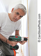 Grey-haired DIY enthusiast