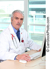 Grey-haired doctor