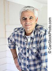 Grey haired handyman