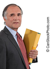 Grey-haired man holding folder