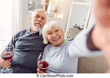 Grey-haired man looking with love at his wife