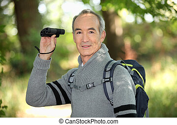 Grey haired man with binoculars