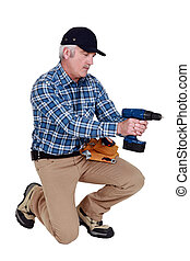 Grey haired man with drill
