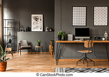Grey home office interior - Patterned posters above desk ...