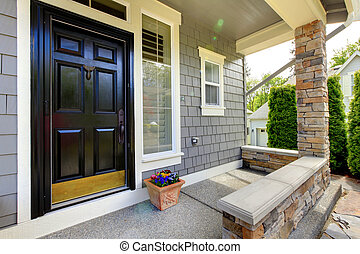Grey house exterior with black door. - Grey house exterior...