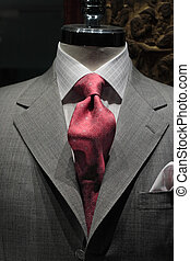 Grey jacket with red tie - Close-up of a grey jacket with ...
