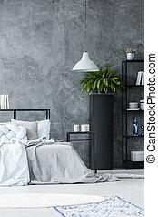 Grey lamp in monochromatic bedroom