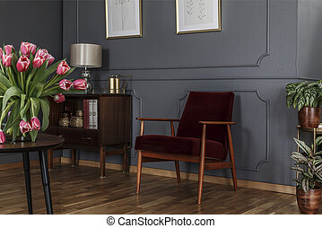 Grey living room interior with wainscoting wall, wooden...