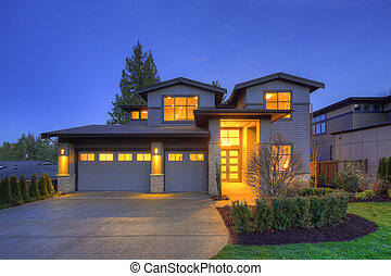 Grey luxury modern two story tall house exterior with stone columns