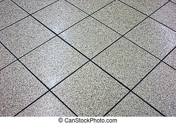 grey marble floor tile angling away, suitable as background image