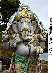 grey marble statue of a Hinduism elephant Shiva vishnu Brahma in a temple near a lake in mauritius africa