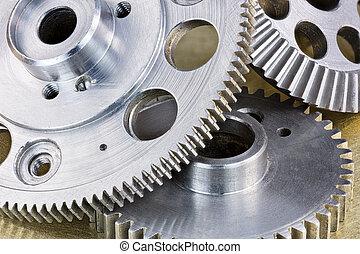 grey metal gear cogwheels on scratched industrial background macro