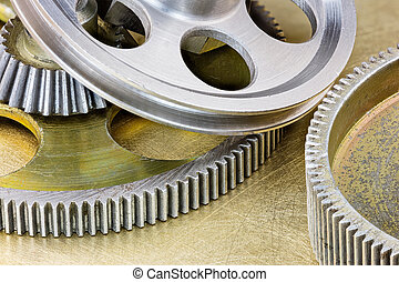 grey metal industrial gear cogwheels on scratched background macro