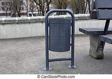 Grey metal trash waste bin in the park - Grey metal steel...