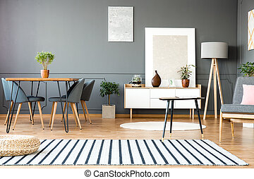 Grey open space interior - Striped carpet in grey open space...