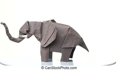 Grey origami elephant. Origami figure exhibition. White...