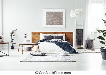 Grey painting in spacious bedroom