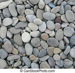 Grey pebbles on the beach as background - Grey pebbles on...