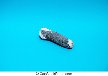 Grey rock against a blue background