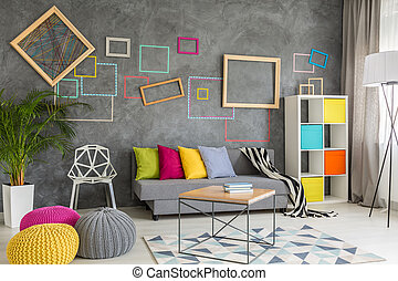 Grey room with colorful accessories