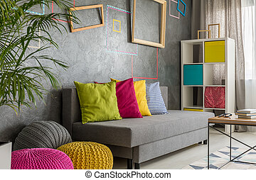 Grey room with colorful poufs