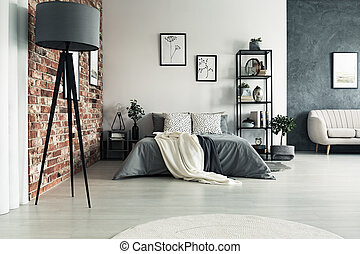 Grey roomy apartment with king size bed, sofa, lamp and one...
